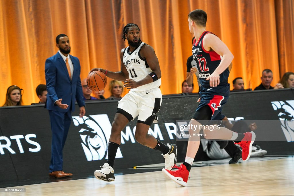 76c359c40 John Holland of the Austin Spurs dribbles the ball during the NBA G ...