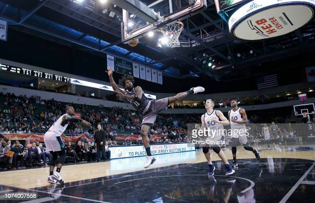 John Holland of the Austin Spurs takes an off balanced shot in front of Canyon Barry and Diamond Stone of the Iowa Wolves after being fouled by Jared...