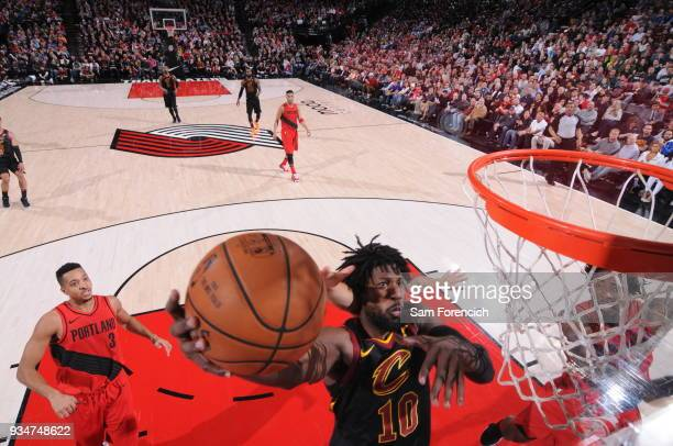 John Holland of the Cleveland Cavaliers dunks against the Portland Trail Blazers on March 15 2018 at the Moda Center Arena in Portland Oregon NOTE TO...