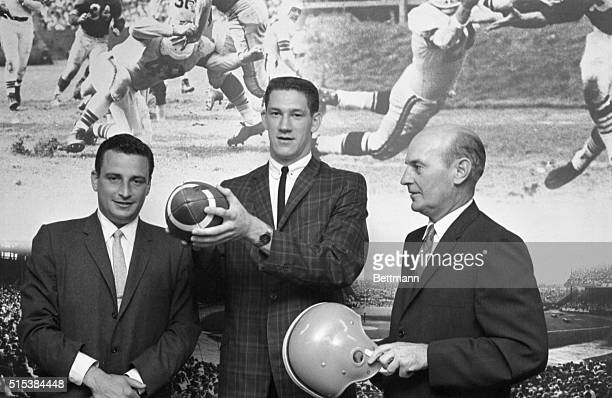 John Hondo Havlicek, , who captained Ohio States' football team last season, poses with the ball, June 13th, after he signed a contract to play for...