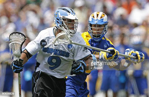 John Hopkins' Paul Rabil left battles Delaware's Alex Moeckel in action during the 2007 NCAA Lacrosse Semifinals Saturday May 26 2007 at MT Bank...