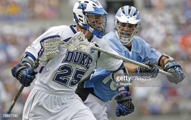John Hopkins' Steven Boyle right presses Duke's Zack Greer during the 2007 NCAA Lacrosse Championship Monday May 28 2007 at MT Bank Stadium John...