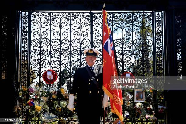 John Houston, formerly of the Merchant Navy, and now flag bearer for the local British Legion, stands outside The Norwich Gates at Sandringham House...
