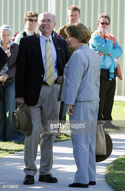 John Howard and wife Janette Howard attend Day Four at the Melbourne International Shooting Club during the Melbourne 2006 Commonwealth Games March...