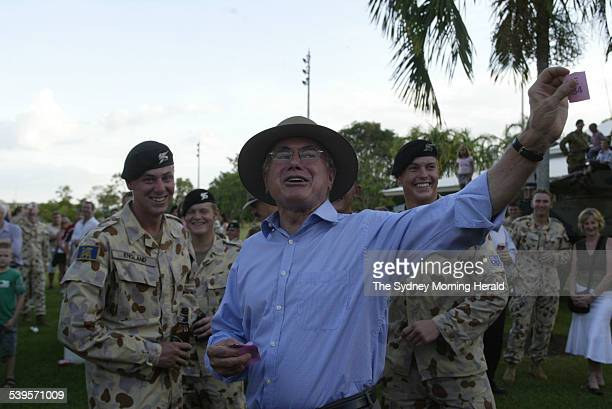 PM John Howard calls for a redraw after winning second prize in a chook raffle at a farewell BBQ at Darwin's Robertson Barracks on the eve of the Al...