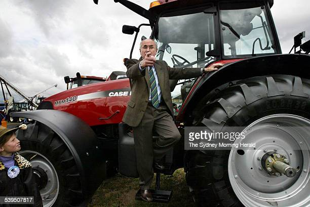 John Howard checks out a tractor during a visit with Deputy Prime Minister John Anderson to the Agqquip Field Day in Gunnedah 18 August 2004 SMH...