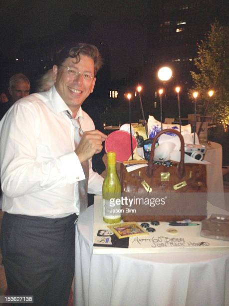 John Howard poses with Cake by Silvia Weinstock circa August 2012 in New York City