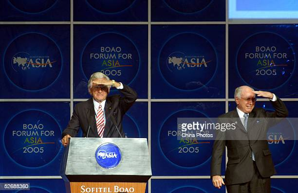 John Howard, Prime Minister of Australia , and Bob Hawke, former prime minister of Australia, gesture during the opening ceremony of the Boao Forum...