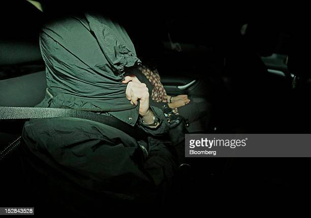 John Hughes former senior trader on the ETF desk at UBS AG is seen covered by a jacket hood while leaving Southwark Crown Court in London UK on...