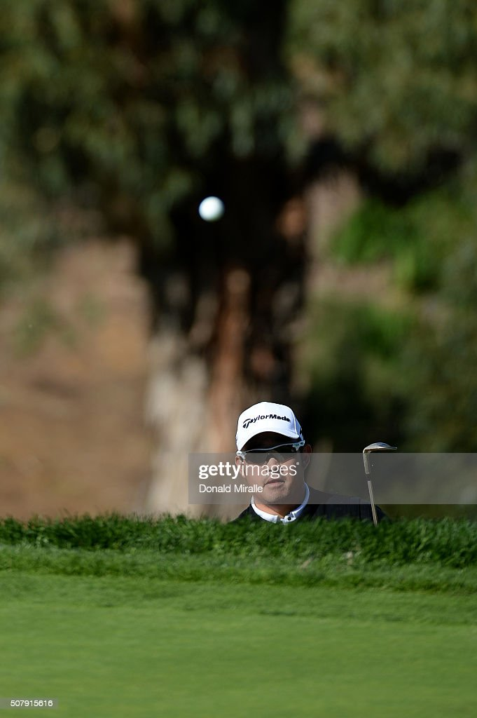 John Huh hits a shot on the 13th hole during the final round of the Farmers Insurance Open at Torrey Pines South on February 1, 2016 in San Diego, California. Play was suspended due to inclement weather on Sunday.