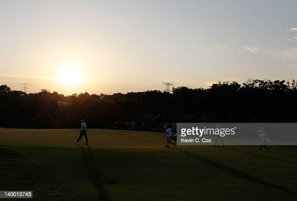 John Huh of the United States and Robert Allenby of Australia walk to the 10th green and the fifth playoff hole during the final round of the...