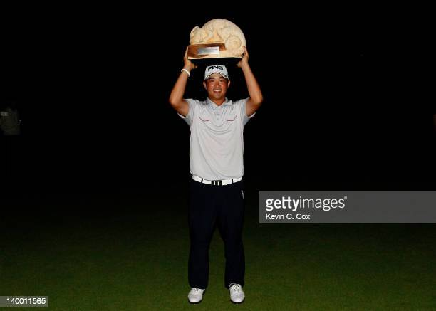 John Huh of the United States poses with the trophy after winning the Mayakoba Golf Classic at Riviera MayaCancún held at El Camaleon Golf Club at...
