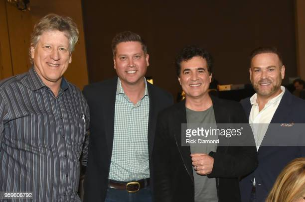 John Huie of CAA Jason Owen of Sandbox ENT CEO of Big Machine Records Scott Borchetta and manager Clint Higham take photos during the Music Biz 2018...