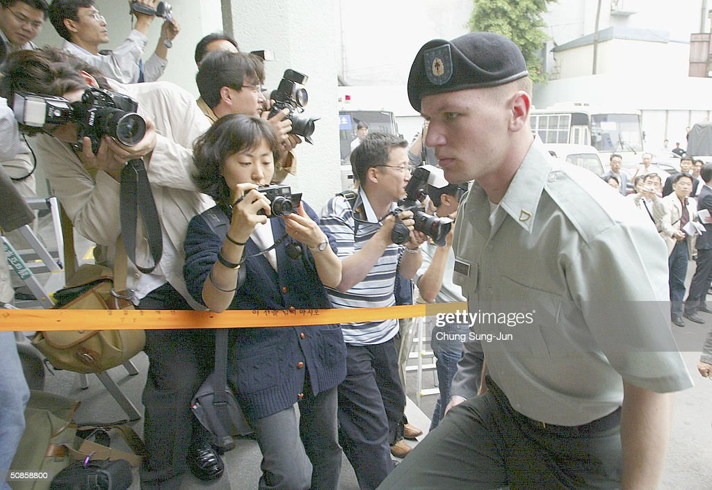 John Humphreys, from the United States Forces Korea (USFK) arrives at a police station on May 20, 2004 in Seoul South Korea. Humphreys and four U.S. soldiers and one Korean soldier were arrested on May 15, following an attack on a 27-year-old civillian who had tried to stop the soldiers from creating a disturbance in the area, the unidentified victim, who was stabbed, underwent surgery on his neck at a nearby hospital and remains in a non-critical condition.