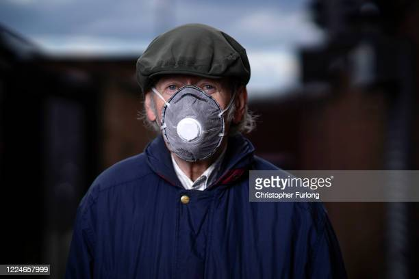 John Humphries poses wearing his face mask as he goes about essential chores on May 13 2020 in Darlaston West Midlands United Kingdom People are...
