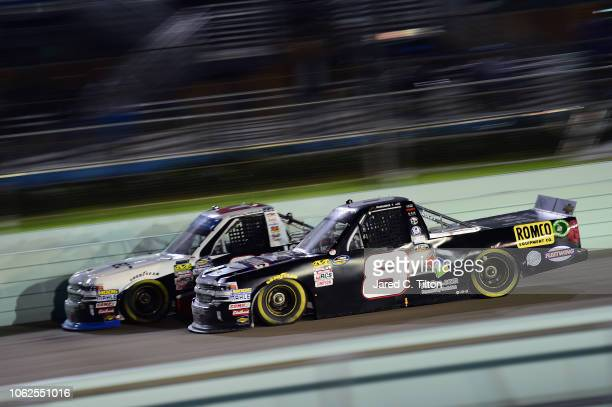 John Hunter driver of the Fleetwing Corporation Chevrolet races by by each with Johnny Sauter driver of the ISM Connect Chevrolet during the NASCAR...