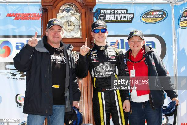 John Hunter Nemchek celebrates in Victory Lane with his family after winning the NASCAR Camping World Truck Series Alpha Energy Solutions 250 on...