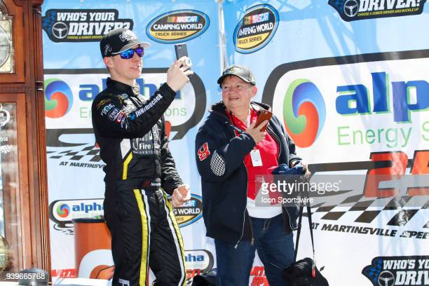 John Hunter Nemchek celebrates in Victory Lane with his grandmother Martha after winning the NASCAR Camping World Truck Series Alpha Energy Solutions...