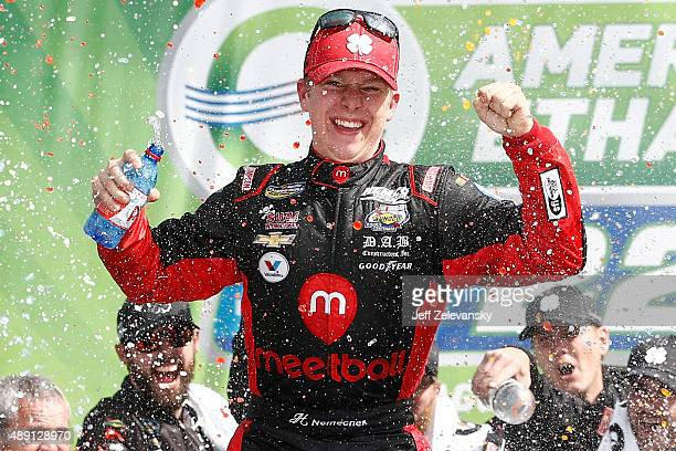 John Hunter Nemechek driver of the Chevrolet celebrates in Victory Lane after winning the NASCAR Camping World Truck Series American Ethanol E15 225...