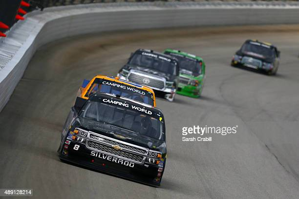 John Hunter Nemechek driver of the Chevrolet leads a pack of trucks during the NASCAR Camping World Truck Series American Ethanol E15 225 at...