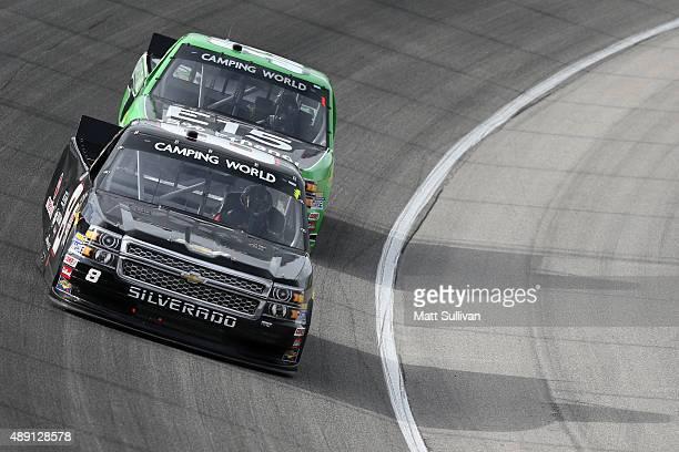John Hunter Nemechek driver of the Chevrolet leads Brandon Jones driver of the American Ethanol Chevrolet during the NASCAR Camping World Truck...