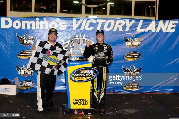 John Hunter Nemechek driver of the Chevrolet Silverado and his father Joe Nemechek pose for a photo after winning the NASCAR Camping World Trucks...