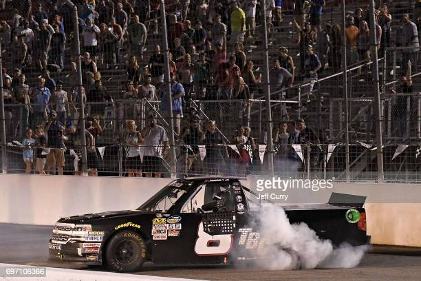 John Hunter Nemechek driver of the Chevrolet Silverado celebrates with a burnout after winning the NASCAR Camping World Trucks Series Drivin' for...