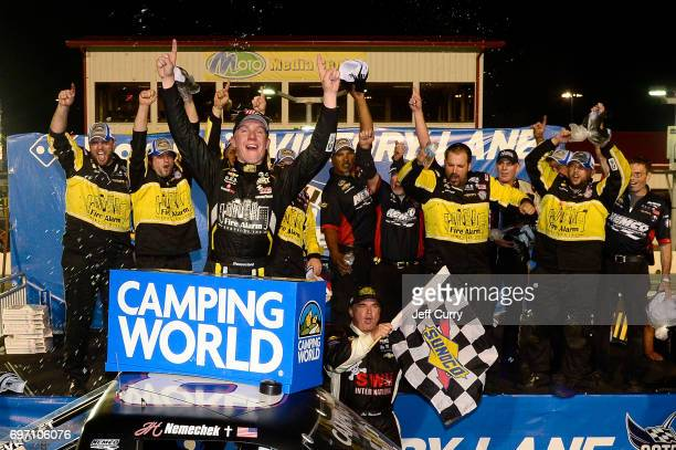 John Hunter Nemechek driver of the Chevrolet Silverado celebrates with his team after winning the NASCAR Camping World Trucks Series Drivin' for...