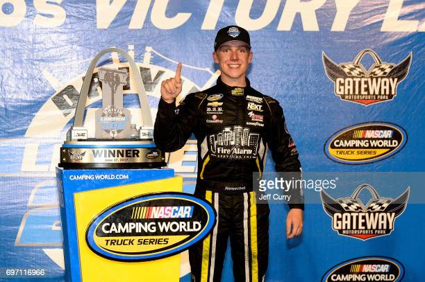 John Hunter Nemechek driver of the Chevrolet Silverado poses for a photo after winning the NASCAR Camping World Trucks Series Drivin' for Linemen 200...
