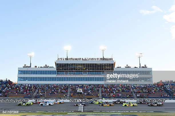 John Hunter Nemechek driver of the Fire Alarm Services Chevrolet leads the field at the start of the NASCAR Camping World Truck Series Speediatrics...
