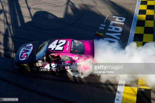 John Hunter Nemechek driver of the Fire Alarm Services Inc Chevrolet celebrates with a burnout after winning the NASCAR Xfinity Series Kansas Lottery...