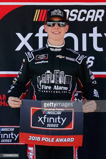 John Hunter Nemechek driver of the Fire Alarm Services Inc Chevrolet poses with the Pole Award after posting the fastest lap during qualifying for...