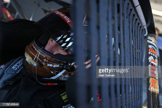 John Hunter Nemechek driver of the Fire Alarm Services Inc Chevrolet sits in his car during practice for the NASCAR XFINITY Series iK9 Service Dog...