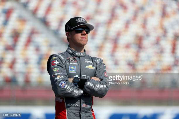 John Hunter Nemechek driver of the Fire Alarm Services INC Chevrolet watches on during qualifying for the NASCAR Xfinity Series Alsco 300 at...