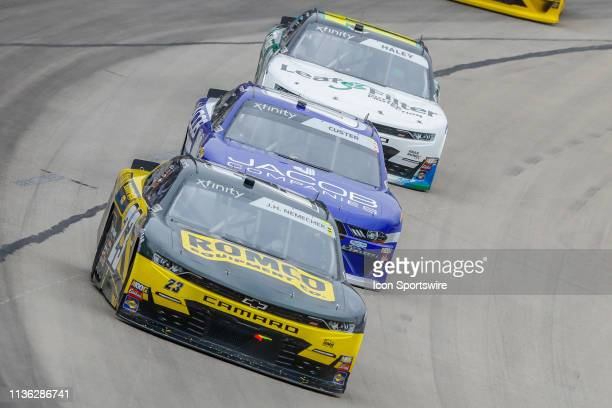 John Hunter Nemechek GMS Racing Chevrolet leads Cole Custer StewartHaas Racing Ford through turn one during the My Bariatric Solutions 300 NASCAR...