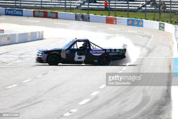 John Hunter Nemechek NEMCO Motorsports Chevrolet Silverado does a burnout after winning the weather delayed running of the NASCAR Camping World Truck...