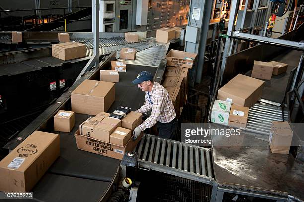 John Hurley sorts packages at the 15 million squarefoot United Parcel Service Inc Chicago Area Consolidation Hub in Hodgkins Illinois US on Thursday...