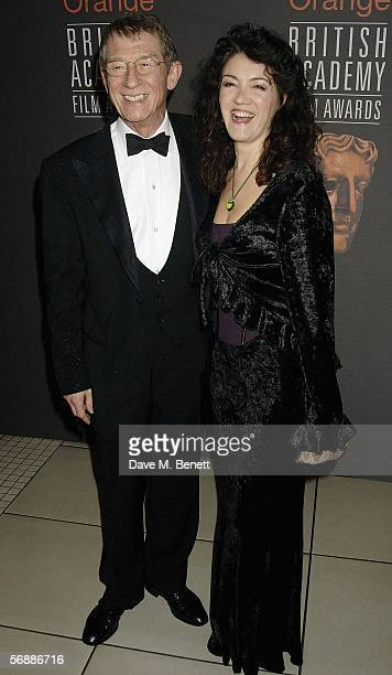 John Hurt and Ann Rees Meyers arrive at The Orange British Academy Film Awards at the Odeon Leicester Square on February 19 2006 in London England
