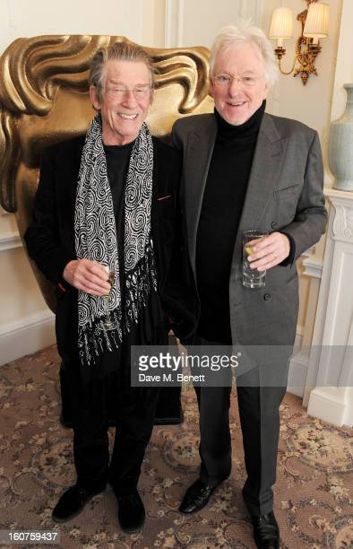 John Hurt and Hugh Hudson attend a drinks reception awarding Sir Alan Parker the BAFTA Fellowship supported by Hackett at The Savoy Hotel on February...