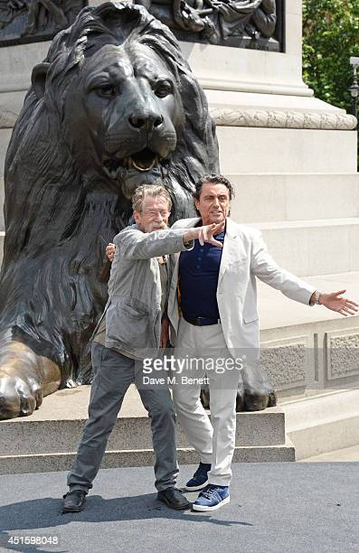 """John Hurt and Ian McShane attend a photocall for """"Hercules"""" at Nelson's Column in Trafalgar Square on July 2, 2014 in London, England."""