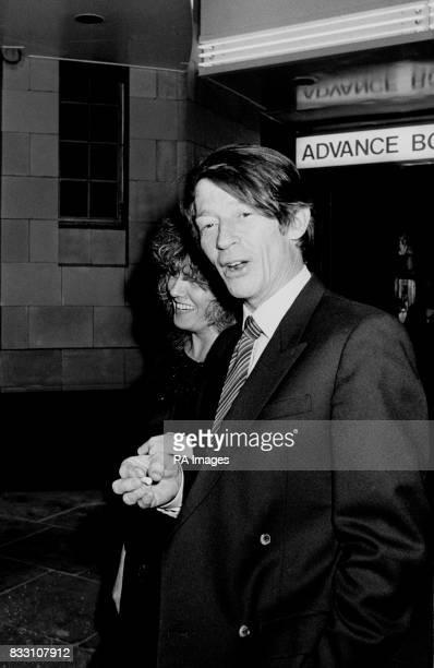 John Hurt arrives for the premiere of Steven Spielberg's Gremlins