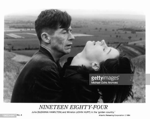 John Hurt holds Suzanna Hamilton in a scene from the film '1984', 1984.