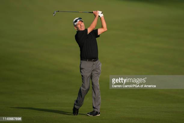May 23: John Huston hits his second shot on the 10th hole during the first round for the 80th KitchenAid Senior PGA Championship held at Oak Hill...
