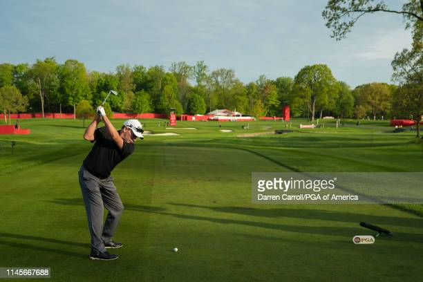John Huston hits his tee shot on the 11th hole during the first round for the 80th KitchenAid Senior PGA Championship held at Oak Hill Country Club...