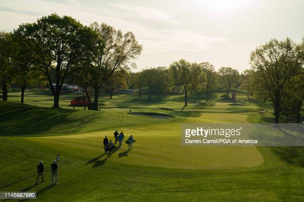 John Huston PGA Professional Mark Brown and Tim Petrovic walk towards the 10th green during the first round for the 80th KitchenAid Senior PGA...