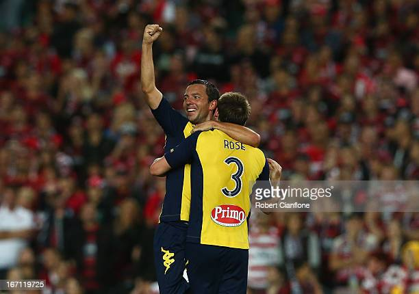 John Hutchinson and Joshua Rose of the Mariners celebrate after the Mariners defeated the Wanderers after the ALeague 2013 Grand Final match between...