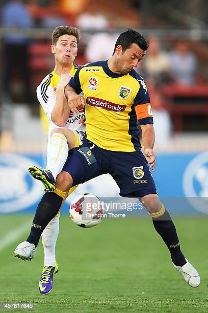 John Hutchinson of the Mariners competes with Jason Hicks of the Phoenix during the round six ALeague match between the Central Coast Mariners and...