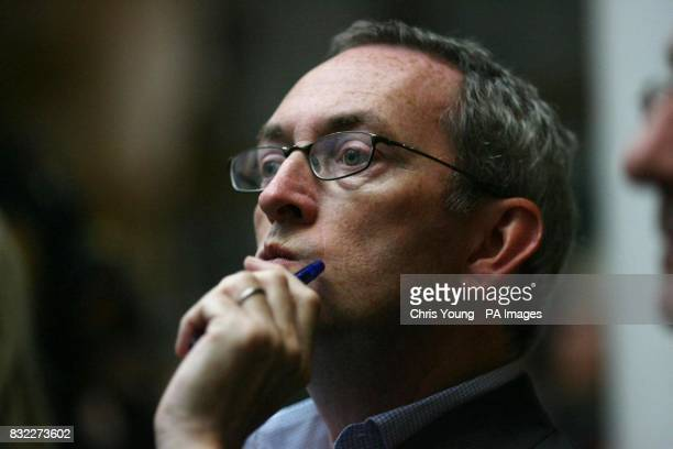 John Hutton listens to Britain's Prime Minister Tony Blair address the thinktank Progress conference in central London