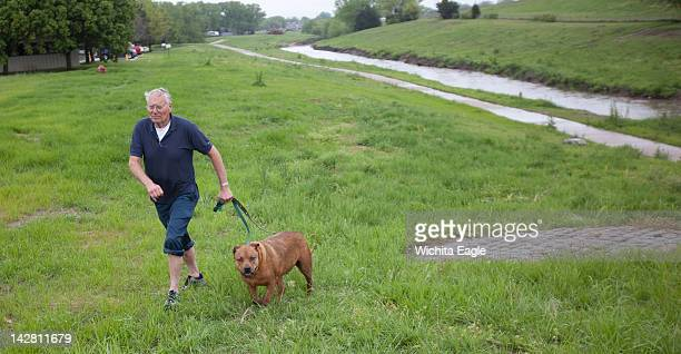 John Huy and his dog Taz head for home after a dramatic day Taz disappeared underwater during a storm on Thursday April 12 in Wichita Kansas After 2...