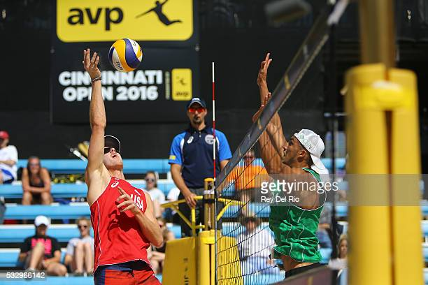 John Hyden of the USA hits the ball over the net against Saymon Barbosa of Brazil during day 3 of the 2016 AVP Cincinnati Open on May 19 2016 at the...